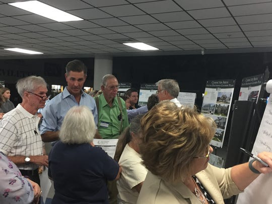 Residents and planners look at information and provide