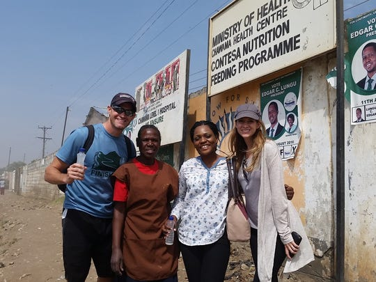 Patrick and Elizabeth Shores in Zambia, pictured with their Zambia project leader and a community based volunteer.