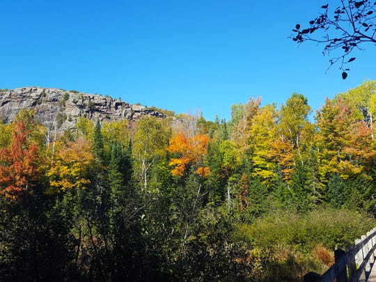 An escarpment looms over Lake of the Clouds and the North Mirror Lake Trail in Porcupine Mountains Wilderness State Park.