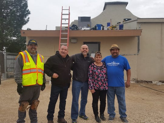 Pictured left to right RoofCARE project supervisor Jesus Aragon, project manager Albert Victoria,CEO Louis Zaina, owners Patricia and Robert Vasquez.