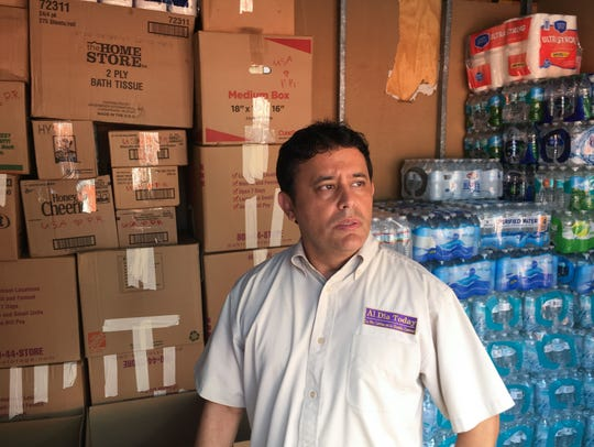 In a 2017 photo, Javier Molinares, president of the Brevard Hispanic Center in Palm Bay, stands with supplies headed to Puerto Rico.