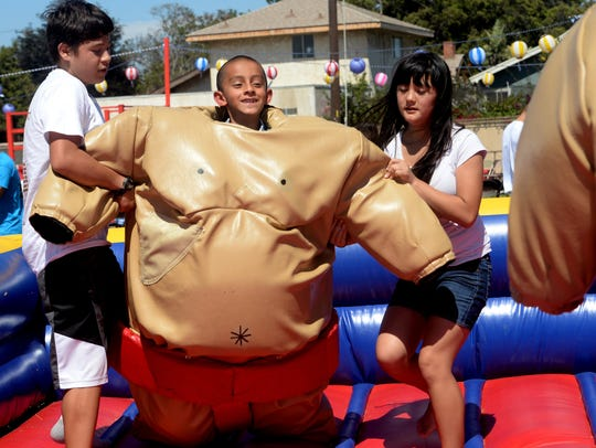 Jacob Murphy wears a sumo wrestling outfit as his brother