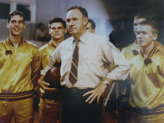 """Gene Hackman with his players during the filming of the movie """"Hoosiers."""" The movie certainly captures the state's obsession with basketball. The movie was shot inside the Hoosier Gym in Knightstown. The movie detailed the fictional team Hickory and their march to the state title, based on the true story of Milan High School and their title in the 1950's."""