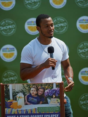 """Green Bay Packers quarterback Brett Hundley speaks at a Shopko event about making a stand against epilepsy. Catch him serving lemonade on June 14 as part of the """"Lemonade for Livy"""" initiative"""