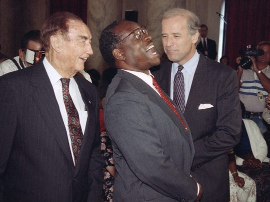 In September 1991, Supreme Court Justice nominee Clarence Thomas laughs while talking with Sen. Strom Thurmond, R-S.C., ranking Republican of the Senate Judiciary Committee, left, and Committee Chairman Sen. Joseph Biden, D-Del., on Capitol Hill in Washington prior to the start of Thomas confirmation hearing.