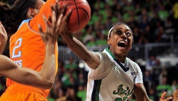 Notre Dame guard Jewell Loyd drives the lane as Tennessee forward Bashaara Graves defends.