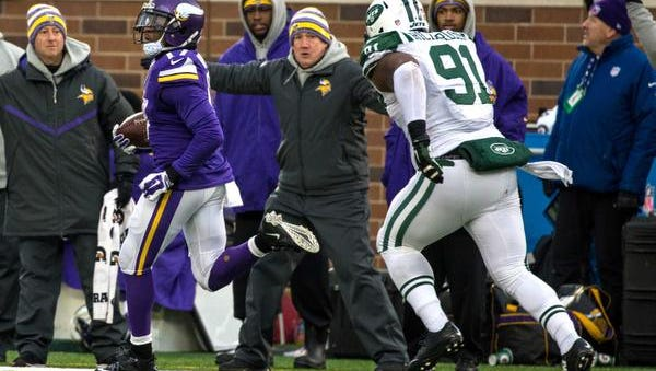 Minnesota wide receiver Jarius Wright, left, breaks free for an 87-yard touchdown in overtime as Jets defensive lineman Sheldon Richardson pursues on Sunday in Minneapolis. The Vikings won, 30-24.