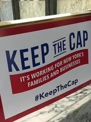 Business groups handed out signs in May in support