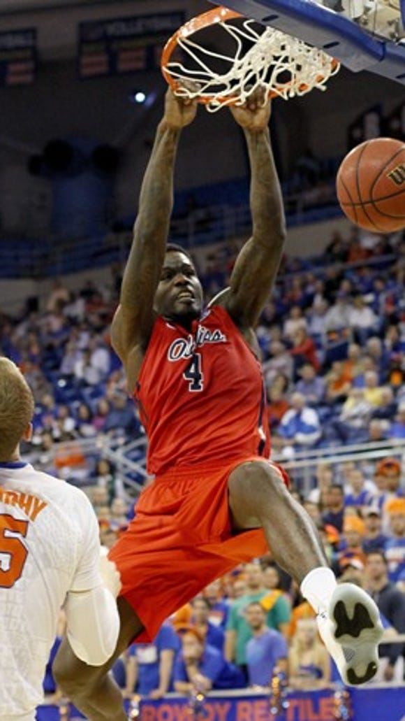 Mississippi forward M.J. Rhett (4) dunks over Florida forward Alex Murphy (5) during an NCAA college basketball game, Thursday, Feb. 12, 2015, in Gainesville, Fla. Mississippi won 62-61. (AP Photo/The Gainesville Sun, Matt Stamey)