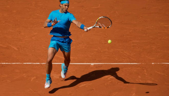 Rafael Nadal (ESP) in action during his match against Andrey Kuznetsov (RUS) on day seven at Roland Garros on May 30, 2015.