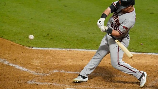 Arizona Diamondbacks' Kole Calhoun hits a single during the fifth inning of the team's baseball game against the Los Angeles Angels on Tuesday, Sept. 15, 2020, in Anaheim, Calif. (AP Photo/Ashley Landis)