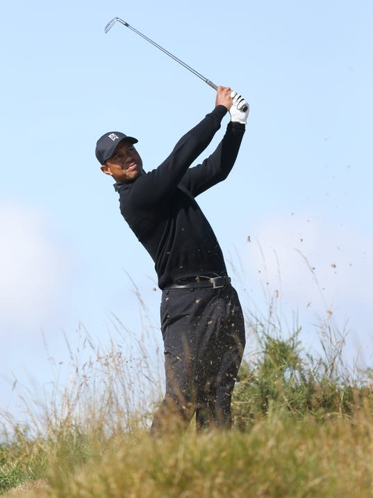 Tiger Woods of the US plays a shot on the 15th hole during a practice round ahead of the British Open Golf championship at the Royal Liverpool golf club, Hoylake, England, Tuesday July 15, 2014. The British Open starts on Thursday July 17. (AP Photo/Peter Morrison)