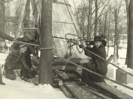 Using boards, ropes and muscle, workers prepared to erect the still-crated Twain monument in Woodlawn Cemetery during winter 1937.