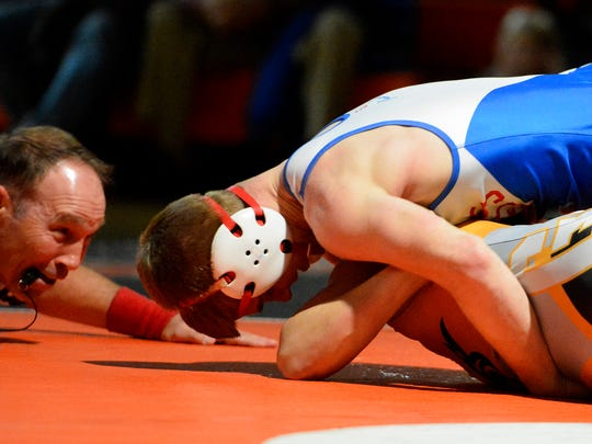 Spring Grove's Dalton Rohrbaugh, top, attempts to pin Mason Myers of  Central York during the 132 pound weight class, Thursday, Dec. 21, 2017. John A. Pavoncello photo