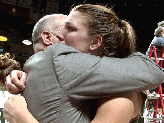 A tear rolls down the cheek of senior Kelly Rhein as head coach Kevin Bankos embraces her following York Catholic's  52-40 win over Northern Cambria in the 2008 state title game.