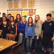 The staff od Beaver Creek Saloon and Grill includes Danny Pixley (back row, from left), Ausrin Barrett, Noah Klavinger, Lindsey Haush, owner David Thompson, Paige Sharrow, Shane Cupps, Rita Veloz (front Row, from left), Rosie Estrada, general manager Misty Lindquistand Cori Mack.