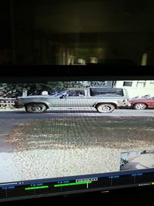 Surveillance footage of the car, believed to be a Ford Bronco II.