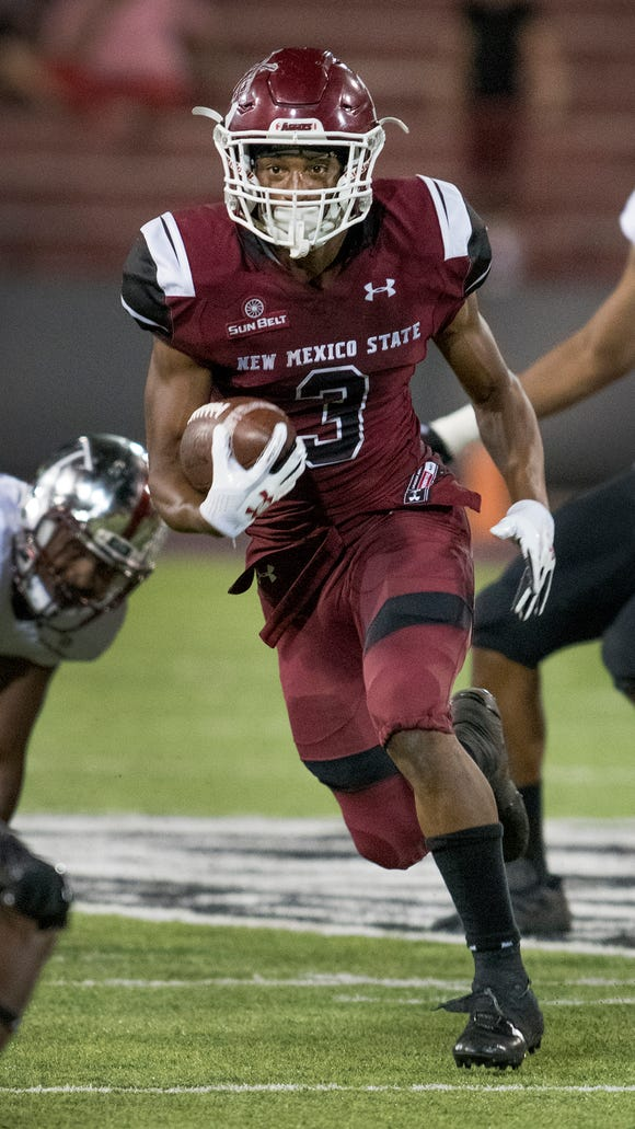 Aggies running back Larry Rose III picks his what through the Troy defense for a nice gain Saturday night at Aggie Memorial Stadium. 9/16/17Gary Mook/ for the Sun-News