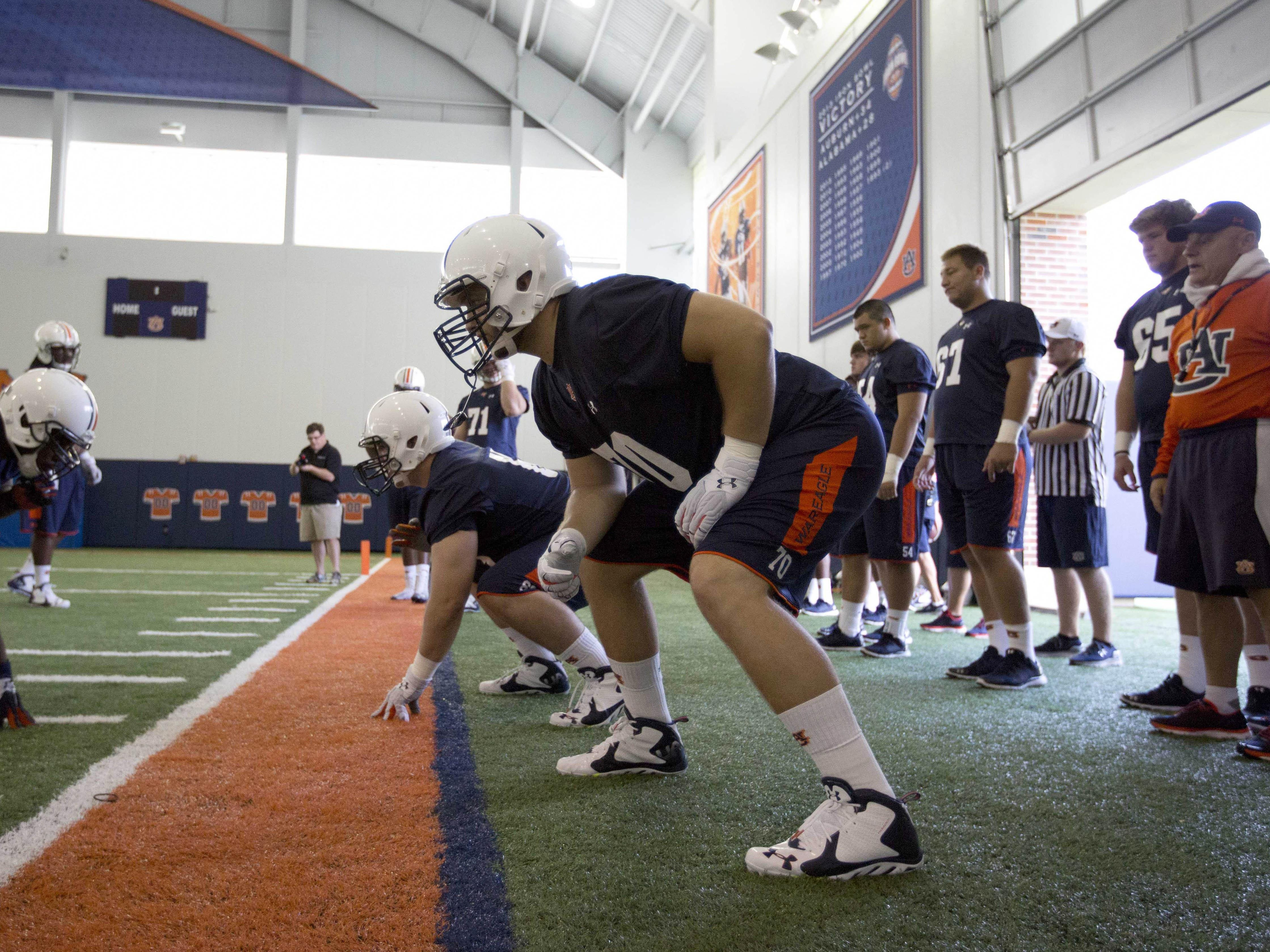 Auburn offensive tackle Robert Leff participates with others in a drill during Wednesday's football practice. Leff and other veterans are helping the freshmen learn the ropes.
