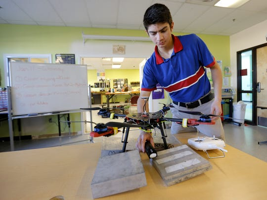 Harmony Science Academy senior Martin Quezada shows off the solar-powered drone he is building in a lab in the East El Paso charter school. A business group has launched an initiative to increase El Paso's education levels, and one way it sees to make improvements is by having more specialized schools in El Paso, including charter schools.