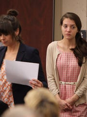 Shayna Hubers, right, enters Campbell County Circuit Court for her murder trial in the shooting death of Ryan Poston.