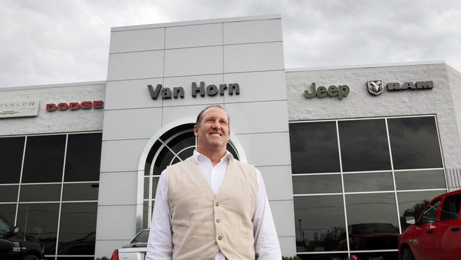 Van Horn owner Chuck VanHorn poses  Wednesday October 5, 2016 at his Plymouth dealership.