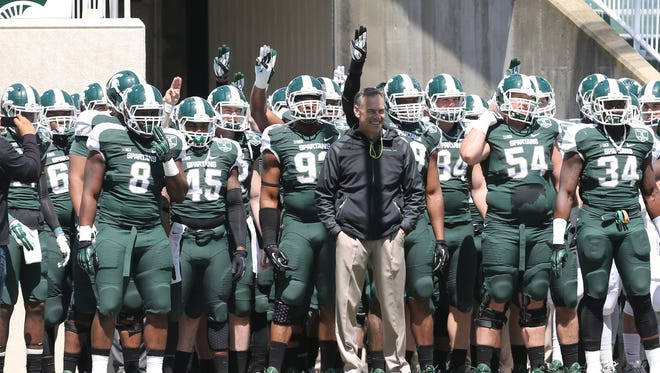 Head coach Mark Dantonio leads his team onto the field for the Michigan State Green and White game last year at Spartan Stadium in East Lansing.