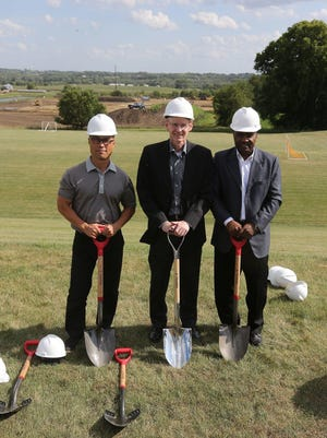 Michael Foods director of operations Chae Kim, president Mark Westphal and director of engineering Howard Weaver pose overlooking the construction site. Norwalk held a ceremonial groundbreaking July 26 for the new Michael Foods facility being built on the city's south side.