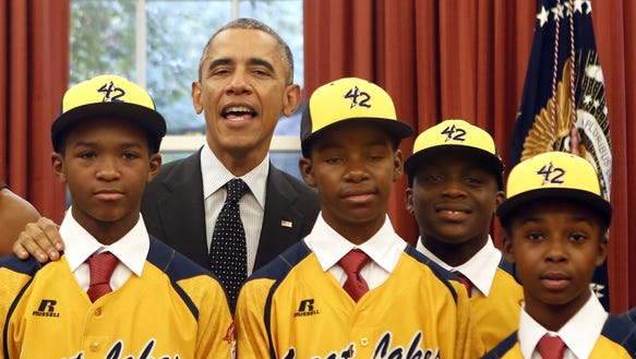 President Obama poses with the 2014 champion Jackie