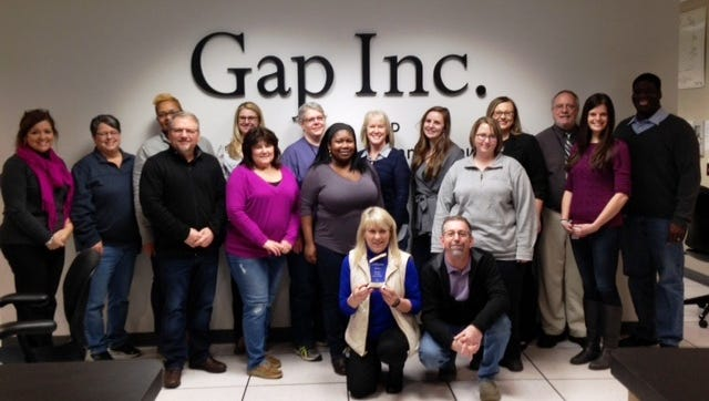 Gap Inc. was recently selected as Workforce Essentials' Employer of the Year. Pictured on front row, from left, are Gap HR Managers Donna Buckelew and Mitchell Spivey.  Second row, Gap employees Dave McAndrew, Rosie Terry, Destinye Johnson, Angela Lash, and Chelsea Byrum.  Third row, Helen Balthrop, Workforce Essentials; Gap employees Tiffany Brawner, Shanda Williams, Jessica McGraw, Amy Yates, Rita Leath, Sophie Barraza, and Jenny Manula, Workforce Essentials; William M. Jones, state of Tennessee; and Kevin Releford, Gap.