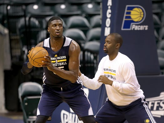 Indiana Pacers practice for their second game agains the Atlanta Hawks Monday, April 21, 2014, afternoon at Banker Life Fieldhouse. Here Pacers center Roy Hibbert,right, does some post work on Jhared Simpson, Pacers assistant video coordinator, following practice.