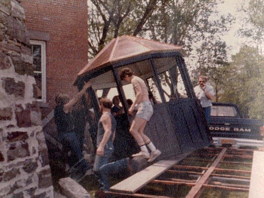 Edison Technical High School students build the lighthouse's new lantern room in 1984.