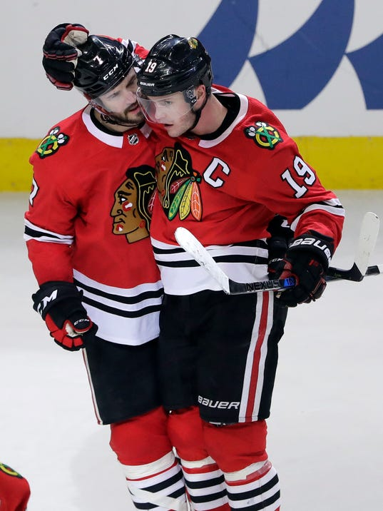 Chicago Blackhawks defenseman Brent Seabrook, left, celebrates with center Jonathan Toews after scoring his goal against the Boston Bruins during the third period of an NHL hockey game Sunday, March 11, 2018, in Chicago. The Blackhawks won 3-1. (AP Photo/Nam Y. Huh)