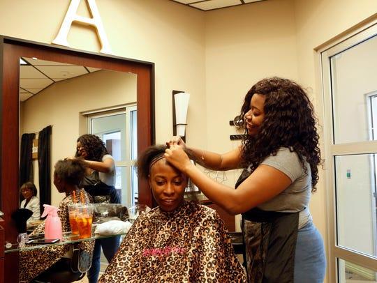 Stylist Ashley Pennington of Congers works on client