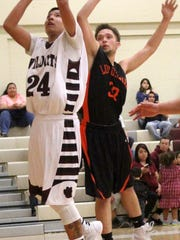 Tularosa's Joe Perez attempts a close-range shot while