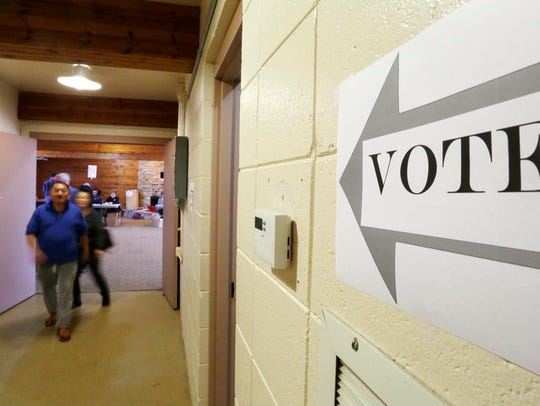 A man and a woman leave the polls at Quarryview Center