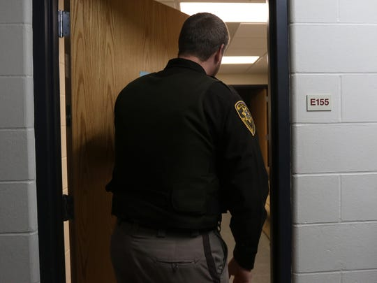 Wood County deputy Aaron Anderson cautiously opens