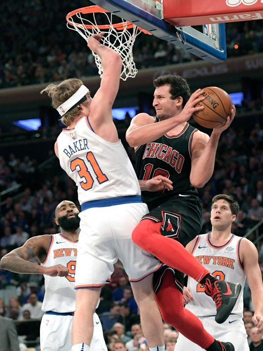 Chicago Bulls forward Paul Zipser (16) goes up with the ball as he is guarded by New York Knicks guard Ron Baker (31) during the second quarter of an NBA basketball game Wednesday, Jan. 10, 2018, at Madison Square Garden in New York. (AP Photo/Bill Kostroun)