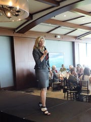 Keynote speaker Carrie Morgridge, vice president of the Morgridge Family Foundation, talks to the crowd at the Jo Covelli Fashion Show & Luncheon to benefit Hibiscus Children's Center.
