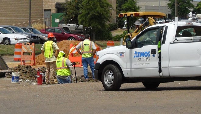 Workers repair a gas leak on Bailey Avenue in Jackson, Miss. Friday, August 21, 2015.
