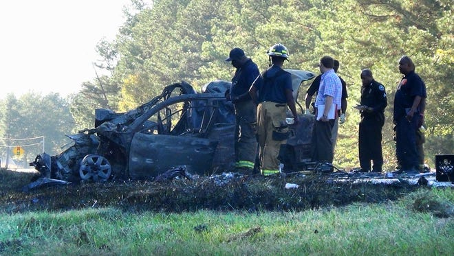 Jackson firefighters and police work the scene of a deadly fiery auto crash on Mississippi 18.