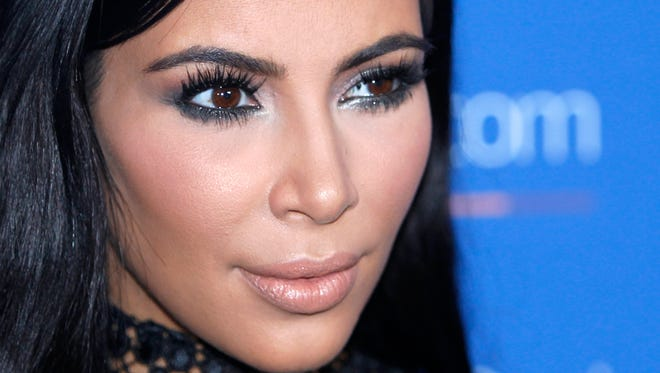 """In this June 24, 2015, file photo, Kim Kardashian West poses during a photo call at the Cannes Lions 2015. An online retailer has pulled a Halloween costume that made light of the recent jewelry heist involving Kardashian West. The costume prompted outrage from some social media users. The company's Twitter account announced Tuesday, Oct. 11, 2016, that the costume had been pulled and apologized if it """"offended anyone."""" (AP Photo/Lionel Cironneau, File)"""