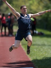 Livonia Franklin's Jacob Cast competes in the long jump.