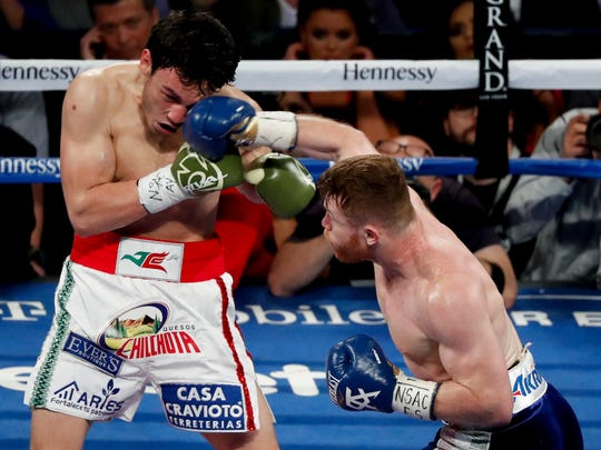 Canelo Alvarez, right, connects to the head of Julio Cesar Chavez Jr. during their fight in Las Vegas on Saturday night.