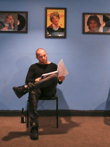 "Patrick Wolz looks through his material before the start of the Open Mic night at The Laughing Derby on a recent Wednesday. It was his first time trying stand-up comedy, something he's always wanted to do. ""I figured I'd jump off the cliff and hope there's water at the bottom,"" he said."
