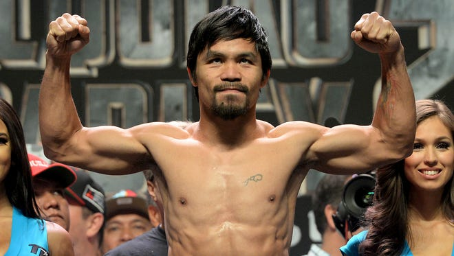 Manny Pacquiao weighs in for his anticipated rematch with Timothy Bradley Jr. for the WBO welterweight title.