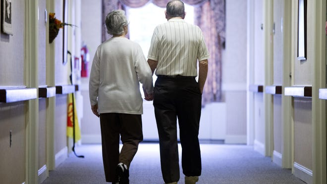 An elderly couple walks down a hall of a nursing home in Easton, Northampton County, in 2015. Research shows fatal falls have nearly tripled in older Americans in recent years, rising to more than 25,000 deaths yearly.