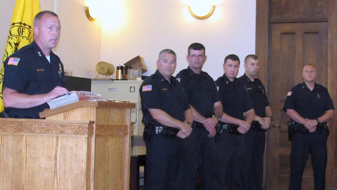 Elmira Police Chief Joseph Kane, far left, introduces several members of the department who were promoted or sworn in as new officers Wednesday. From left are Lt. Scott Packard, Lt. John Perrigo, Sgt. Matthew Saunders, Officer Justin Stamp and Officer Isaac Marmor.