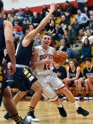 Dover's Brady Bowman drives against Eastern York in