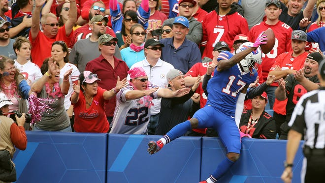 Bills receiver Justin Hunter jumps into the stands to celebrate his 30 yard catch for a touchdown against the 49ers.